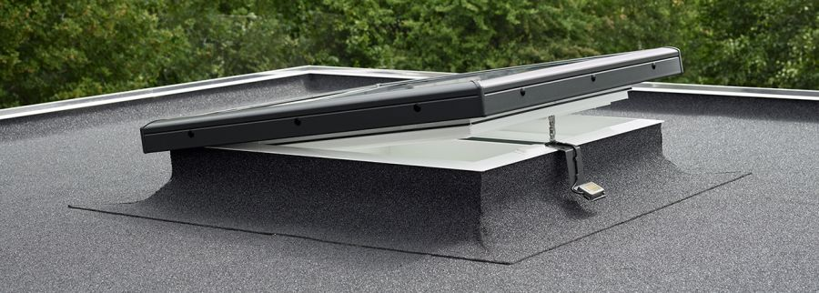 Velux electric flat glass rooflight clear for flat roof for Velux cladding kit